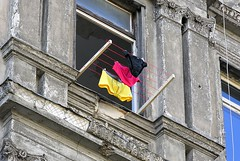 The German Flag ([martin]) Tags: building berlin window weather germany colours pants martin flag clothes national shorts prenzlauerberg ontheline martinbiskoping