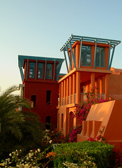 A garden view: Sheraton Miramar Resort El Gouna, Hurghada - Egypt (mnadi) Tags: flowers blue sunset red summer sky orange holiday flower colour garden warm colours outdoor redsea curves egypt sunny resort arabic clear gouna egyptian styles sheraton ethnic spa miramar hurghada michaelgraves bedouin  nubian elgouna bougainvilleas