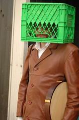 Milk crate on head - by Joming Lau