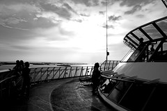 Sunset in port (jacreative) Tags: cruise sunset sky blackandwhite bw sun clouds ship belize royalcaribbean enchantmentoftheseas jacreative