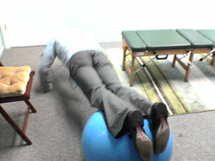 Excercise ball pushups at the Chiropractor's o...