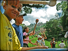Speaking the language of their forefathers (carf) Tags: poverty girls brazil music boys brasil kids youth children drums hope kid community education support capoeira child hummingbird esperana social impoverished underprivileged altruism entrepreneurship shanty educational drumming beijaflor favela development investment prevention larmariaesininha morrodomacaco