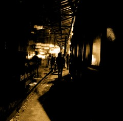 Gleaming corridor (... Arjun) Tags: 2005 city shadow urban bw 15fav topf25 monochrome sepia 1025fav 510fav hall nikon singapore shiny topc50 d70s corridor 100v10f noflash hallway 1870mmf3545g glossy 2550fav 500v50f walkway strip 50100fav access passage 1000v100f luminous tinted polished gleaming glassy passageway lustrous glinting bluelist 100200fav