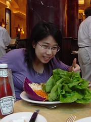 Woman enjoys salad atop The Beanstalk (a.k.a. The Cheesecake Factory). Photo by gizzypooh.