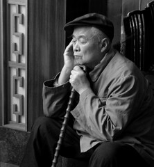 Reverie (GustavoG) Tags: china old portrait bw man cane interestingness shanghai market spotlight elderly elder utata bazaar daydream yuyuan reverie puxi beautifuloldage myownfavorites