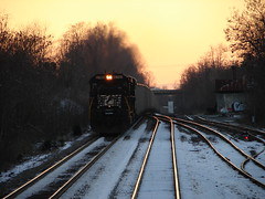 Eastbound evening coal (Luke Sharrett) Tags: old railroad sunset snow abandoned ice forest train ties bedford virginia track norfolk tracks engine railway southern lynchburg locomotive headlight powerplant coal relfection norfolksouthern 8749
