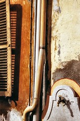 Shutters and Pipes (ljcybergal) Tags: italy champoluc valdaosta holiday travel shutters pipes water tap yellow brown grey