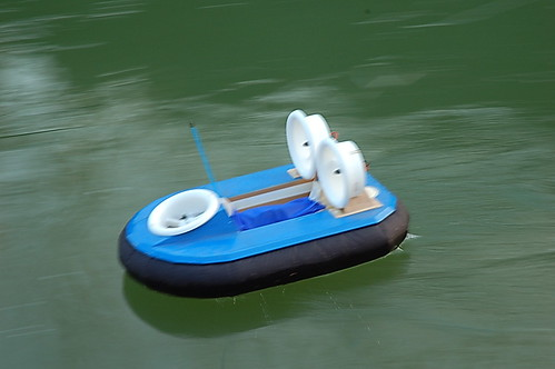 Model hovercraft on canal