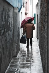 Big Umbrella, Narrow Alley (Foto Blitz Color) Tags: street travel vacation italy rain umbrella alley nikon europe moody d70 burano payitforward scoreme judgmentday54