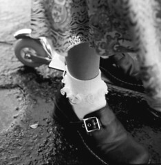 1,2, Buckle My Shoe (WadeB) Tags: bw film topv111 1025fav 35mm wow shoe diy sock 28mm trix hc110 scooter driveway canonae1 buckle frill selfdeveloped