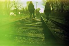 Walking on rail (joohell) Tags: usa cross eerie process expiredfilm superfatlens