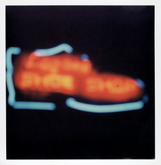 Logan's Shoe Shop Bokeh (tobysx70) Tags: the impossible project tip polaroid slr680 frankenroid sx70 door rollers color film for 600 type cameras impossaroid logans shoe shop west hickory street denton texas tx neon sign lit illuminated night nocturnal bokeh outoffocus oof polacon2016 polaconone 100116 toby hancock photography