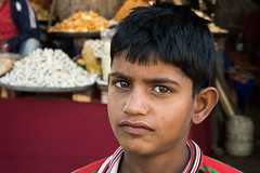 Curious Eyes (Karunyaraj) Tags: pusharfair pushkar rajasthan kid cutelook cuteexpression cuteeyes dynamiclook boy little red potrait look eyes cwc chennaiweekendclickers cwc561 nikond610 d610 nikon24120