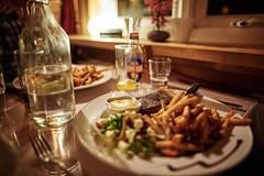 Steak with Fries (bacon.dumpling) Tags: bottle bottleofwater dish entrée food indoor nikond750 nopeople nobody sigma24mmf14dghsmart grindavík iceland
