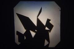 Casting Shadows with Origami (Eleanor Harding) Tags: shadows shadow light dark sharp lines folds creases