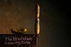 The Hesitation Hindering Fame (Studio d'Xavier) Tags: werehere picklevision pickle green surreal balance stilllife strobist thehersitationhinderingfame
