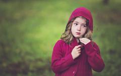 Red Riding Hood got lost (Wojtek Piatek) Tags: red portrait green girl grass lost sweater tears child sad sony knit riding hood cry zeiss135 sonya99