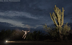 Taking Flight (Eric Binns Photography) Tags: arizona cactus sky selfportrait southwest clouds jump desert saguaro sonorandesert tontonationalforest offcameraflash pocketwizard 10secondtimer strobist offcameralighting