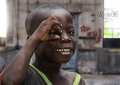 Clicking you! (Ram Iyer Photography) Tags: africa lighting street boy portrait face kids nikon colorful flickr awesome young streetphotography sharp portraiture popular strobe nationalgeographic facebook tweet awarded nikonflickrawardgold tweter ramiyer ramiyerphotographycom
