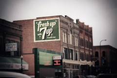 It Likes You! (Pete Zarria) Tags: southdakota sign ghost 7up drink old vintage smalltown street