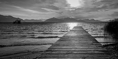 light behind the jetty ... (hjuengst) Tags: chiemsee lake jetty clouds light alps bavaria blackandwhite panorama wave sunset chieming stöttham
