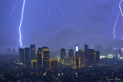 Awe-inspiring lightning lights up Makati City in the Philippines (Sumarie Slabber) Tags: light lightning city cityscape manila philippines makati sumarieslabber skies sky night storm thunderclouds nature bolts skyline skyscrapers rockwell