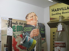 The Taste that Refreshes - Liquid Chocolate Cocoa Crush 0464 (Brechtbug) Tags: the taste that refreshes liquid chocolate cocoa crush cardboard standee ad billboard advertisement 01212017 new york city billboards poster shadows afternoon soda soft drink straw diet can bottle glass milky milk smiling winking man sidney greenstreet type guy 1930s straws sipping