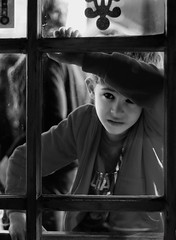 The Boy in the Window (photo_secessionist) Tags: boy window street expression pentax km smcaf250mmlens digital blackwhite bw bn