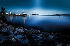 Deep Blue (Žèę Ķ) Tags: cold winter richmond bluehour blue sea ocean landscape seascape boat vessel rock stones lighthouse night dark landscapes outdoor longexposure calm serene reflection