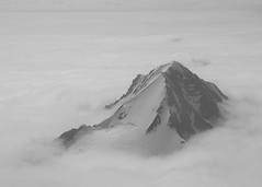 Above the Clouds (nicnac1000) Tags: above sky snow rock alaska clouds peak anchorage piper alaskarange