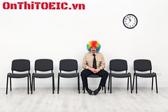 Last man standing - waiting concept (tienganh_com_vn) Tags: white man silly clock smile businessman wall shirt relax fun happy office chair waiting funny humorous alone sitting adult time empty room clown humor young handsome business indoors impatient romania wait nervous late after candidate worker hours concept copyspace interview job stressed confident zany career restless relentless optimistic buffoon applicant