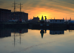 Cool Sunset reflections at Liverpool (Tony Worrall) Tags: liverpool merseyside mersey scouse northwest england northern uk update place location north visit area county attraction open stream tour country welovethenorth unitedkingdom scenic scene serene reflections wetreflection wet water calm cool cold dusk color colours beauty masts docks ship relic