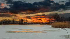 Ice and fire 4 (piotrekfil) Tags: nature landscape winter sunset sky clouds reflections island ice snow lake dusk twilight pentax poland piotrfil