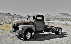 soak up the sun...(HTT) (BillsExplorations) Tags: truck truckthursday rust abandoned old vintage rhyolite nevada mining ghosttown desert selectivecolor nationalregisterofhistoricplaces bullfrog
