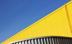 Yellow White and Blue (Andrea Kennard) Tags: industrial metal warehouse construction architecture blue business background industry wall new modern building sky iron storage structure abstract texture outdoors roof pattern facade factory exterior garage entrance commercial steel distribution roller shutter workplace property trading company cladding unit freight import yellow