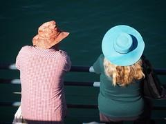 Two Hats in Santa Monica (Feldore) Tags: santa monica pier candid sunhat hats sitting california birdseye view street two people feldore mchugh em1 olympus 1240mm sunlight