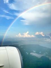 Into the rainbow (e.bonomini) Tags: sky colors flying rainbow singapore teal