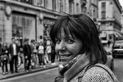 IMG_7791-Edit (roger_thelwell) Tags: life street city uk winter portrait england people urban bw white black streets cold london lamp monochrome westminster beauty hat rain leather mobile umbrella hair bag walking real photography mono chat shiny phone traffic post natural photos britain circus cigarette candid cab taxi great sac hats cell photographic smoking lamppost photographs oxford conversation shiney talking shoulder handbag stud speak speaking studs commuters