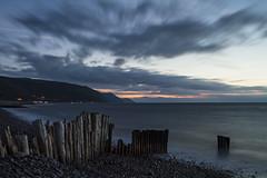 Rekindled Fire (RattyBoots) Tags: longexposure sunset sea canon twilight waves somerset 7d exmoor groynes porlock canon24105 bossingtonbeach