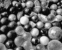 Spheres (Adobe Garamond) Tags: sphere ball pottery round dirty group roundness glass tranparent black white bw size different treasure spheres falling crap