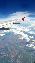 Small white patches.  #fly #wing #airborne #above #high #birdseye #scenery #landscape #plane #sky #clouds #cumulus #cirrus #travel #horizon #distant #Asia #Thailand #plains #tropical #tropics #Indochina #window (Tapsiful Asia) Tags: above travel sky window clouds plane landscape thailand fly high scenery asia horizon wing cumulus tropical plains airborne tropics birdseye cirrus distant indochina