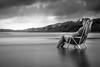 Stuck in the Ocean (heitorpergher) Tags: preto e branco monocromático black white monocrome água nikkor 35mm f18 nikon d5200 beach cloudy nublado rain chuva long exposure
