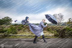 Learn to fly (Moneyfish.) Tags: fly rain umbrella fake wind hei boy art dutch huizen holland jong young outside storm canon netherlands nature