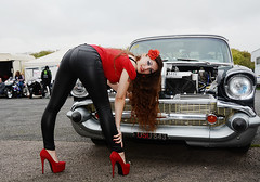 Holly FT   148 (Fast an' Bulbous) Tags: 57 chevy chevrolet american car vehicle automobile drag race fast speed power people outdoor girl woman chick babe long brunette hair red shoes high heels stilettos tight leather jeans pvc leggings model pinup beauty nikon santa pod england