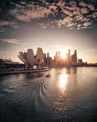 Faraway (Scintt) Tags: singapore buildings architecture rain weather clouds sky sun light glow large format slow shutter fuji 100f slide colour positive film silver 4x5 gaoersi 58mm wide angle super angulon schneider travel vintage lines patterns textures yellow iconic surreal scintillation scintt jon chiang photography sunset astia marina bay mbs cbd art science artscience museum epic dramatic evening rays crepuscular beams reflections water ripples twilight orange golden vibrant natural colours tourism urban modern reservoir tetenal self developed diy