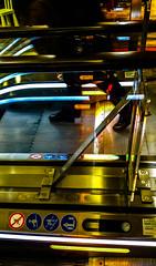 2017-01-21 – Lumière sur mes pas (Jacqueline Lemay et André Proulx) (Robert - Photo du jour) Tags: janvier 2017 lumièresurmespas jacquelinelemayetandréproulx escalier escalator pieds lumières couleurs jambes noir