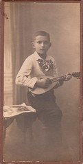 Portrait of a boy with a mandolin by Atelier Stein (c.1910) (pellethepoet) Tags: boy portrait music berlin germany deutschland europe child mandolin bowtie kind artnouveau photograph musicalinstrument junge knabe wilhelmstein photoprop chausseestrase atelierstein