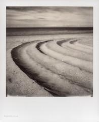 Beach Tracks (Roj) Tags: blackandwhite bw film beach monochrome analog landscape polaroid sx70 mono seaside instantphotography colwynbay tyremarks filmisnotdead impossibleproject originalphotographer photographersontumblr