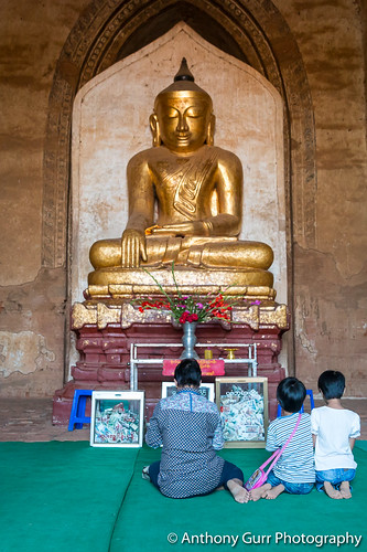 Praying to a Buddha in Dhammayangyi Temple in Bagan, Myanmar