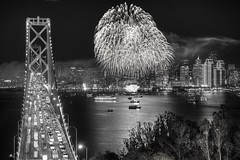 Häppy New Year, lots of compassion and success in 2017! (PeterThoeny) Tags: sanfrancisco sanfranciscobay sanfranciscobayarea california newyear happynewyear fireworks skyline city skyscraper light night clear treasureisland yerbabuenaisland outdoor monochrome blackandwhite embarcadero bridge sanfranciscobaybridge baybridge traffic architecture bay water reflection waterreflection wetreflection nex6 sel50f18 1xp hdr photomatix qualityhdr qualityhdrphotography fav200